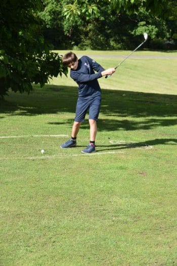 Elstree School boy playing golf